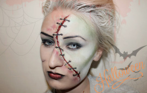 Using face paints, scar wax, black wire and stage blood.