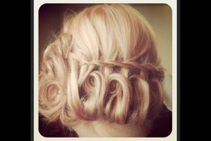 Waterfall braid twisted up to create a pretty updo
