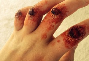 Owwch! Busted my knuckles! Hahaha just kidding! I used mehron liquid latex, fake blood, and creme paints.