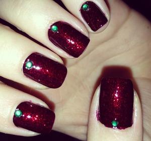 2 coats of Milani Black Cherry 1 coat of Milani Ruby Jewels I got my nail crystals from etsy :)