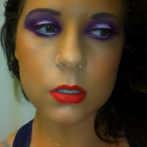 the look starts white(middle of lid) then blends to pink and in deep purple. and a bold Lady Danger by Mac Lipstick!