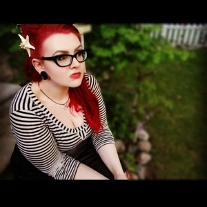 This is a shot that a friend of mine took of me for a makeshift shoot we did.   I was attempting for a Rockabilly look and went a bit Ariel on it.<3