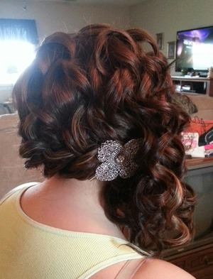 I used a curling wand for curls, loosely french braided hair to side and pinned.