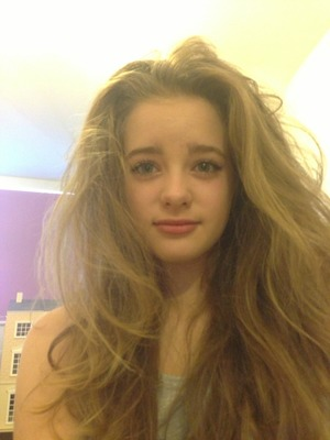 Natural makeup half straightened hair