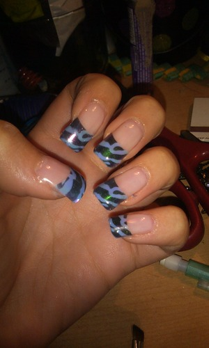 gel nails with a teal zebra tip :)