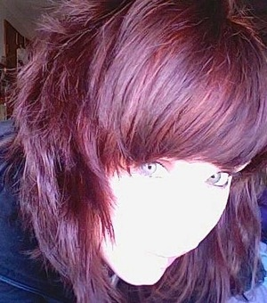 """Taken with webcam in direct sunlight, sacrifice of facial features to capture hair color! This was the """"after"""" shot of a whole block of LUSH's Caca *Rouge* Mama. (I used a 1/2 block for each dyeing, 2 days apart.) I am tagging the Noir and Brun because th"""