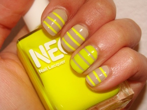 Neon stripes on nude polish