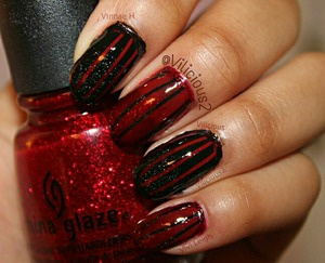 Glittery black and red stripes! I used striping tape for the stripes, and a makeup sponge for the gradients. All of the nail polishes I used were: Nicole by Opi Razzle Dazzler, Zoya Storm, Rimmel London Stiletto Red and, China Glaze Ruby Pumps. I really liked this mani. :)