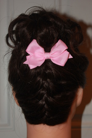 Very cute, upside down french braid, bun.