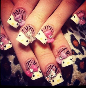 Gorgeous hello kitty nails with bling bows. My personal favorite.