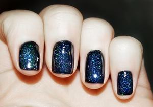 This is a really great nail polish from Barry M. It's black with tiny glitters, I topped it off with a extra sprinkling of micro-glitter and a top coat of super shine from Sally Hanson. Simple and easy galaxy nails with no messing around :) GFx