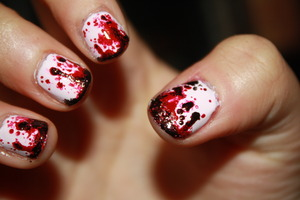 Bloody nail art for Halloween. :)    Tutorial here: http://www.youtube.com/watch?v=dQDOjboswYY&feature=plcp