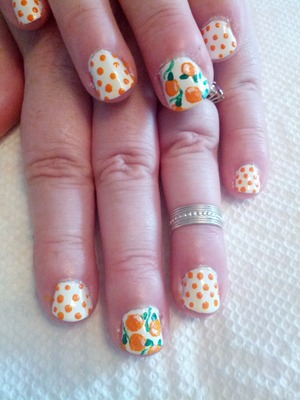 Inspired by totally-nailed. I used a China Glaze texture polish for the oranges to give them that orange skin kinda look :)