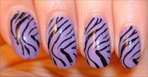 Purple Zebra Nails (This was my very first time using the Konad stamping kit!) More photos here: http://www.swatchandlearn.com/nail-art-funky-purple-zebra-manicure-using-the-konad-m57-image-plate-konad-nail-art-swatches/
