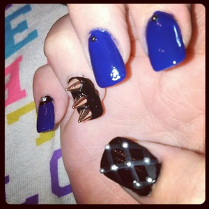 spiked black and blue nails with studs