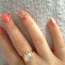 Sparkly bright nails with rhinestone bow