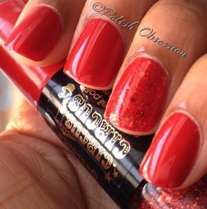 Dual ended polish with a red creme and red glitter.  http://www.polish-obsession.com/2013/02/essence-applause-applause.html
