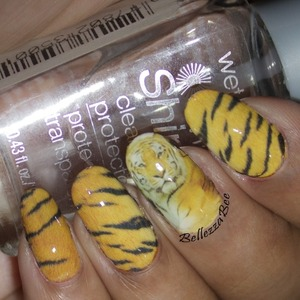 Blog: http://www.bellezzabee.com/2014/04/tiger-striped-out-nail-art.html