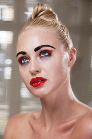 black eyebrow, red glossy lip, orange eyeshadow