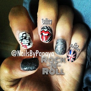 So, one of my supporters from facebook.com/BeautyByPapaya requested that I do a Rock-N-Roll themed mani so, I DID! :) This hand features a music sheet finger, a Rolling Stones themed finger which i had A LOT of fun doing, and the British flag to represent The Beatles. My other hand does feature an ACDC themed nail, an Elvis themed nail, and a guitar however, I'm still working on doing details on my right hand with my left sooooo.... I won't post that one til then! Enjoy!