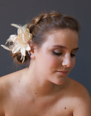 Marina's bridal look: polished makeup and dutch braid with side bun up-do