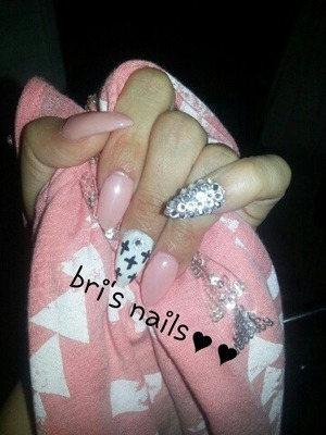 light pink and white gel polished on top of acrylic nails crosses and pinky is a silver acrylic with clear Swarovski Crystals