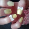 Yellow Nails With 3D Bows