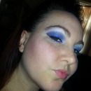 Blue,  grey, and white eye with a pink lip