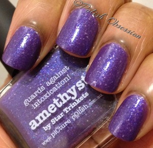 Purple base with silver flakies and shimmer  http://www.polish-obsession.com/2013/02/picture-polish-amethyst.html#