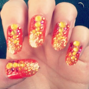 I did these nails for the launch of the Electric Picnic 2013 festival to make it feel more summery ;) They're a mixture of an ombré design with two NYC polish colours, with a sprinkle of glitter towards the tips of the nails and then exaggerated with gold and red rhinestones falling from the glitter to the base of the nail. They were rockin!