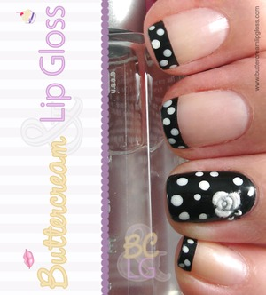 Black tips with white polka dots.