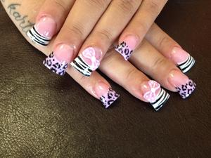 acrylic animal print nails with 3D bows jersey style nails.