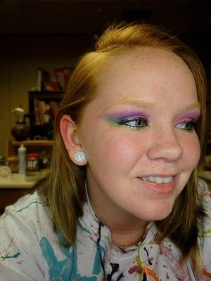 Colors: Purple, blue, neon green, fuchsia pink.
