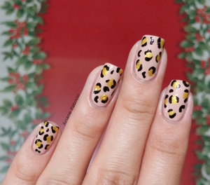 For Katrice's version: http://www.beautylish.com/f/rpyzjig/leopard-twin-nails-with-ariane-p