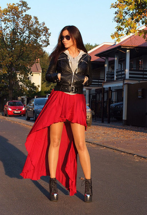 Red skirt, featuring deep cut out front with asymmetric hem, a stretchy waist, light weight fit and lined design.