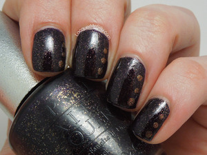 OPI DS Mystery with added accent dotting. More information and photos can be found on my blog post: http://www.lacquermesilly.com/2013/05/20/opi-ds-mystery/