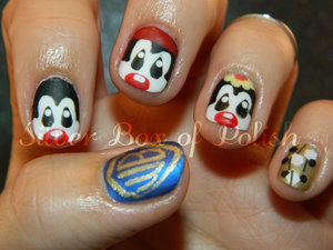 Nail art inspired by the 90s cartoon, Animaniacs. Featured designs: Warner Brothers logo, Yakko, Wakko, and Dot!