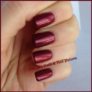 """this is a """"mood potion"""".  This is Little Bruiser in it's cold state.  A deep vampy reddish purple."""