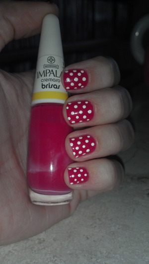 Bright pink with white dots.