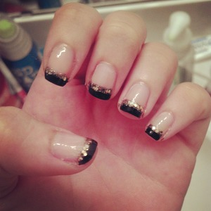 Black tips with gold glitter