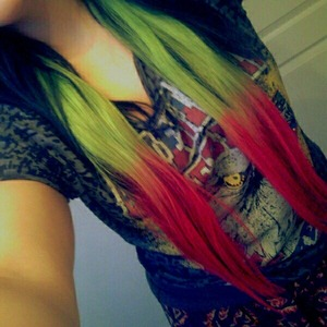 Hair Straightened(: Also, the pink is the exact color but the green is more vibrant, it's neon! Especially in the sun(: