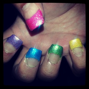 did a full set of acrylic French tips then painted thwm rainbow. colors