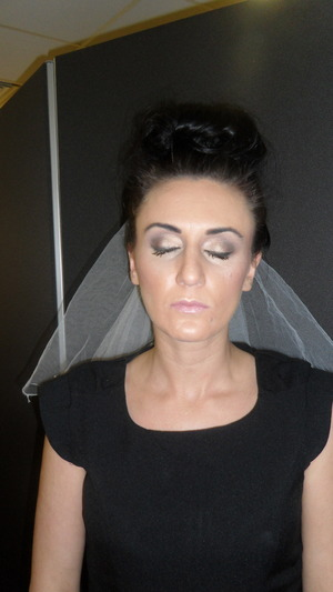 This look was for an assessment in college for my bridal look. I used 2 different shades of mac eyeshadows and mac vanilla pigment to blend on the brow bone.