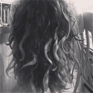 This, my friend, is what my hair does when I go to the beach. My waves turn into knotted dread-like pieces. >.<