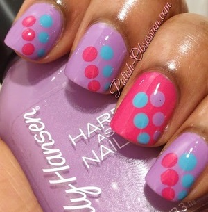 I used Sally Hansen No Hard Feelings as a base and added polka dots using my dotting tool with Sally Hansen Fuchsia Power and Barry M Turquoise.  On my accent nail I used Fuchsia Power as a base and No Hard Feelings and Turquoise for the polka dots.  http://www.polish-obsession.com/2013/06/show-some-love-saturday_15.html