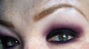Black/gray smokey eye blended out with purple
