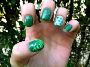 St. Patrick's day nails - green with skulls, polka dots, and sparkles! By Hannah at monrogue.com