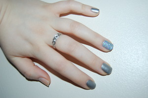 silver glitter nail using Rebel nail wraps and Holographic glitter