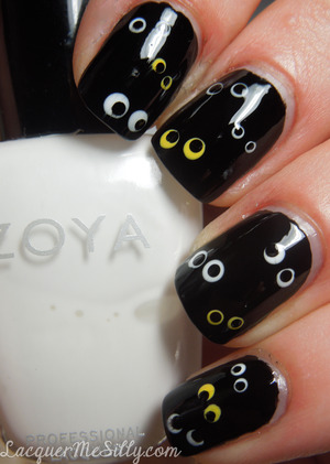 Super simple mani inspired by the creepy little things that may be lurking in the dark ;) For full details visit my blog here http://www.lacquermesilly.com/2012/10/29/peekaboo-i-see-you/