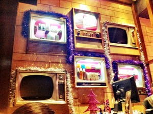 "This is the reception of ""Waxing Divas"". I loved the use of old TVs and radions on the walls that are now shelves or flat screens."